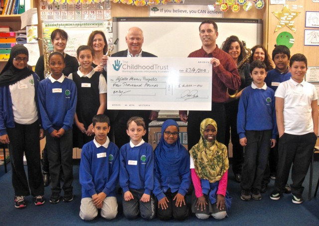 The Childhood Trust trustee David Lewis presents Apollo Music Projects' CEO David Chernaik with a cheque for £4,000.